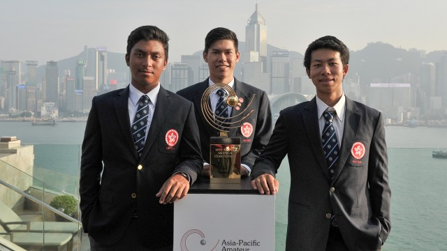 Hong Kong: Leon Philip D'Souza (L), Matthew Cheung (C), Michael Regan Wong (R) of Hong Kong posing with the Asia-Pacific Amateur Championship trophy overlooking the Victoria Harbour in Hong Kong prior to the 2015 Asia-Pacific Amateur Championship at the Clearwater Bay Golf & Country Club in Hong Kong on September 30, 2015. (Photo by Mike Casper/AAC)