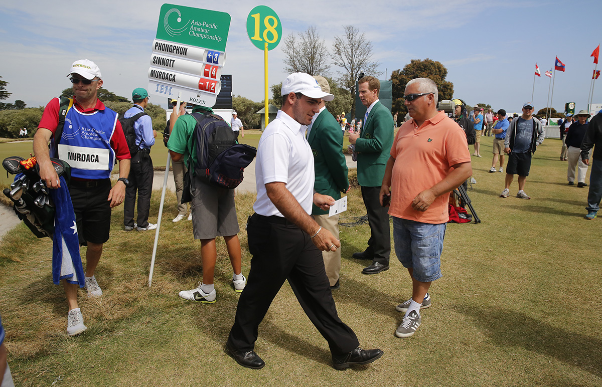 Melbourne, Australia: Antonio Murdaca of Australia walks through the gallery after holing out on 18 to shoot 67 in round 3 of the Asia-Pacific Amateur Championship at the Royal Melbourne Golf Club). October 25 2014, (photo by Dave Tease/AAC)