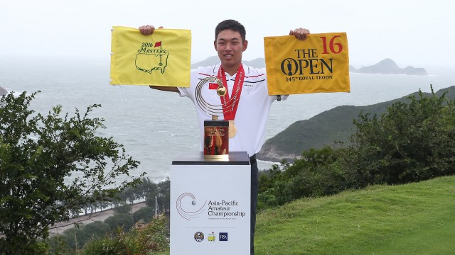 Hong Kong: Cheng Jin of China poses with the Asia-Pacific Amateur Championship trophy while holding the Masters and Open flags after winning the 2015 Asia-Pacific Amateur Championship at the Clearwater Bay Golf & Country Club in Hong Kong on October 04, 2015. (Photo by Alex Liew/AAC)